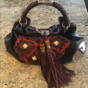 Gucci bag with python and purple tassels
